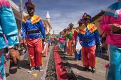 Homens em trajes coloridos no Corpus Christi Fotografia de Stock Royalty Free