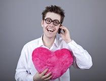 Homens engraçados com coração do brinquedo. Imagens de Stock Royalty Free