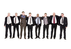 Homens felizes em uma fileira Imagem de Stock