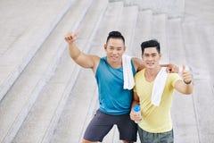 Homens fortes felizes Foto de Stock