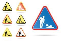 Homens no sinal de estrada do trabalho Foto de Stock Royalty Free