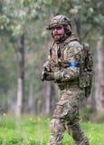 Homens no uniforme militar com arma Imagem de Stock