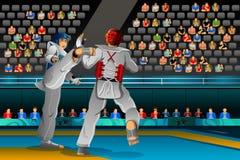 Homens que competem em uma competição de Taekwondo Fotografia de Stock Royalty Free
