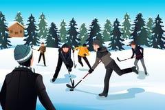Homens que jogam o hóquei em gelo Fotografia de Stock Royalty Free