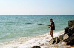 Homens que pescam no mar de Azov Fotos de Stock Royalty Free