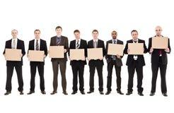 Homens que prendem sinais Fotos de Stock