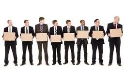 Homens que prendem sinais Imagem de Stock Royalty Free