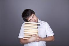 Homens tristes com livros e o caderno branco. Fotos de Stock