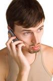 Homens tristes novos com telemóvel Imagens de Stock