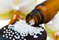 Homeopatía. Glóbulos como medicina alternativa Foto de archivo libre de regalías