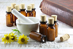 Homeopathic arnica pills Stock Photography