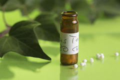 Homeopathic bottles and Pills Stock Images
