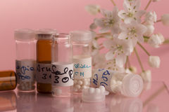 Homeopathic bottles and Pills Stock Image