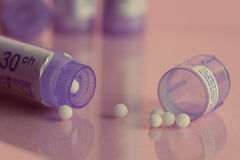 Homeopathic bottles and Pills Royalty Free Stock Image