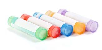 homeopathic läkarbehandling för färgrika behållare arkivbilder