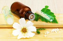 Homeopathic medication with flower and leaf stock images