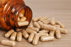 Homeopathic medicinal capsules. Herbal and homeopathic medicine in capsules Royalty Free Stock Image