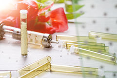 Homeopathic medicine, syringe and flower Stock Photography