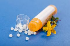 Homeopathic pills and Hypericum Stock Photo