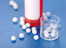 Homeopathic pills and plastic containers Stock Photo