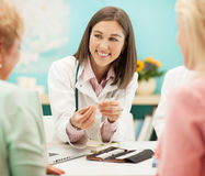 Homeopathist and Patients Stock Images