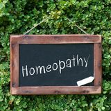 Homeopathy. Blackboard with chalk and text: Homeopathy Stock Photography