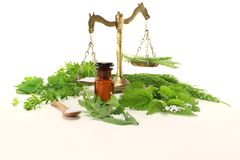 Homeopathy with apothecary scale Stock Photography