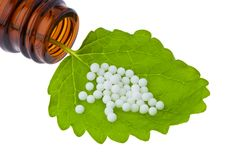 Homeopathy. Globules as alternative medicine royalty free stock photography