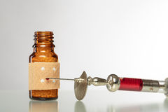 Homeopathy globules. syringe with blood and  pla Stock Image