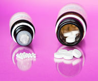Homeopathy. Homeopathic globules and tablets out of a bottle Stock Photos