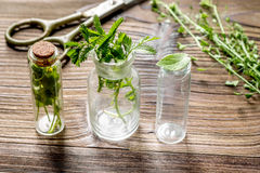 Homeopathy. Store up medicinal herbs. Herbs in glass on wooden table background stock image