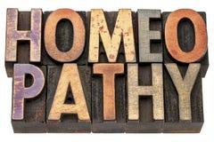 Homeopatiord i wood typ arkivbild