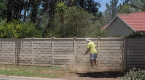 Homeowner moving lawn during drought conditions Stock Photos