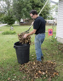 Homeowner Putting Leaves In A Trash Carrel Royalty Free Stock Photos