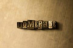Homepage - close-up vintage sujo da palavra typeset no contexto do metal Imagens de Stock Royalty Free