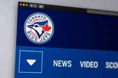 Homepage de la p?gina web de los Toronto Blue Jays del equipo de b?isbol Ci?rrese para arriba de logotipo del equipo fotos de archivo