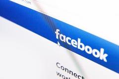 Homepage do logotipo de Facebook em uma tela de monitor Fotografia de Stock Royalty Free