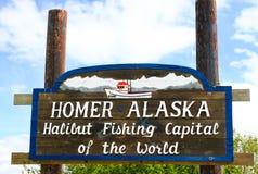 Homer Alaska - Halibut Fishing Capital. This sign greets visitors on the Kenai Peninsula as they enter world famous Homer, Alaska, also known as the Halibut Stock Image