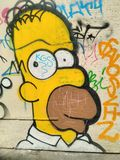 Homer Simpson graffiti. Homer Jay Simpson is a fictional character and the main protagonist of the American animated sitcom The Simpsons as the patriarch of the Royalty Free Stock Images