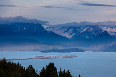Homer Spit in Kachemack Bay surrounded by glacier filled mountains. Glorious landscape of the Homer Spit in Kachemak Bay with glacier filled mountains in Stock Photos
