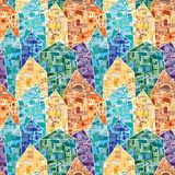 Seamless vector pattern with colorful houses decorated as a mosaic with many geometric details. Yellow, orange, blue and green pattern stock illustration