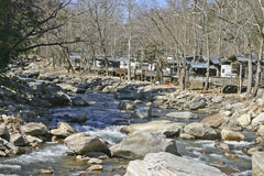 Homes Along a Rocky River Royalty Free Stock Images