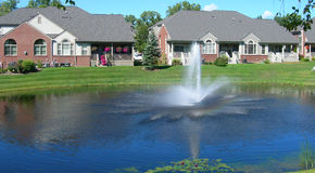 Homes around a landscaped pond Royalty Free Stock Photos