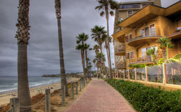 Homes by the Beach with Pathway. Several homes with balconies look out over pathway and beach Stock Images