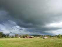 Homes and beautiful cloudy sky, Lithuania Royalty Free Stock Photo