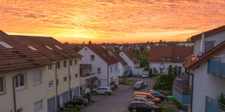 Homes and cars in a sunset Royalty Free Stock Image