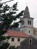 Homes and church tower in city center Bakar in Croatia Stock Images