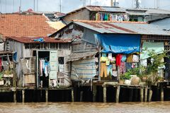 Impoverished homes on Vietnamese river Royalty Free Stock Image
