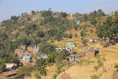 Homes in the foothills. Houses splashed along the foothills amongst the terraces in Gorkha How amazing to see homes looking so precariously close to the edge stock image