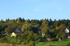 Homes in the Forest. A small idyllic village in the forest stock photography